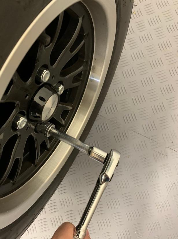 Loosen wheel nuts for one rear wheel